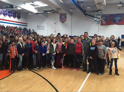 Travis Bornstein poses with students at his presentation at Revere High School  on November 21.