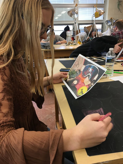 Junior Brittany Whitlam works on a project in her Drawing and Design class.