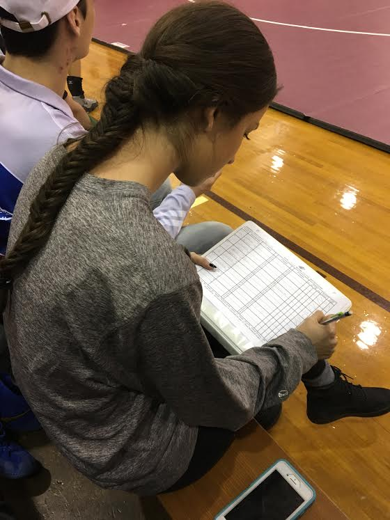 Eisland marks stats for the team.