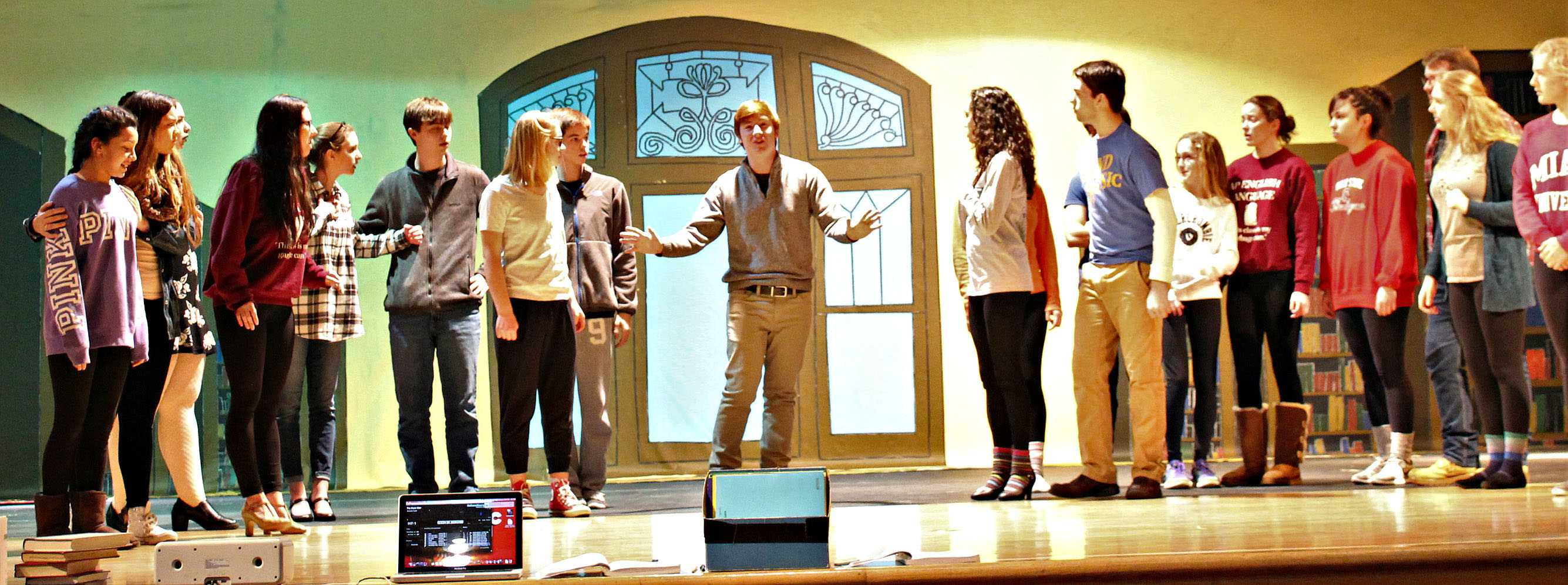 The ensemble cast rehearses the larger numbers every day after school with the direction of Russell.