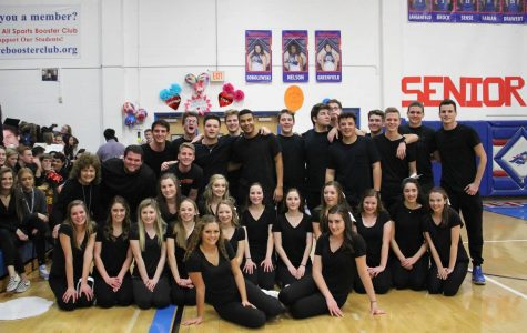 Cheerleaders pair with senior boys in annual dance