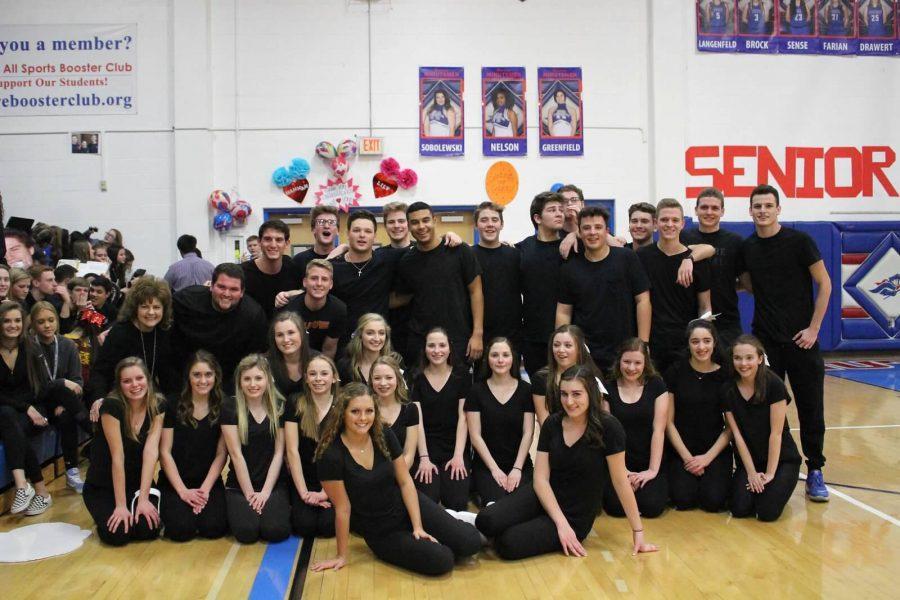 Cheerleaders pair with senior boys in annual dance