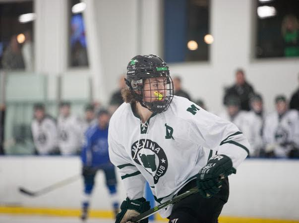 Junior Nolan Printy warms up for a game.