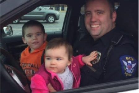 Officer Shaffer poses with his children.