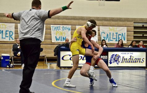 Freshman Zayne Lehman attempts to take down a copley opponent.