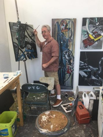 Pierson works on his projects at his art booth at the Cleveland Institute of Art.