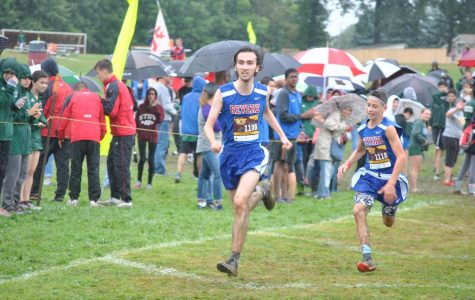 Junior Alexander Landis and freshman Chase Teter run the final stretch of the Pat Richie Invitational.
