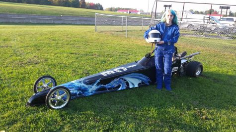 Mitschke poses with her dragster.
