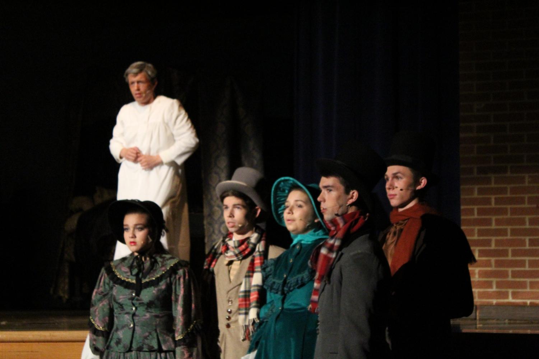 Narrators from left to right: Molly Oldham, William Marchetta, Sasha Desberg, Tylor Davis and Eric Dye with lead Joe Restivo as Ebenezer Scrooge