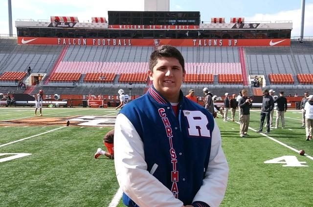 Christman stands in front of the Bowling Green football field.