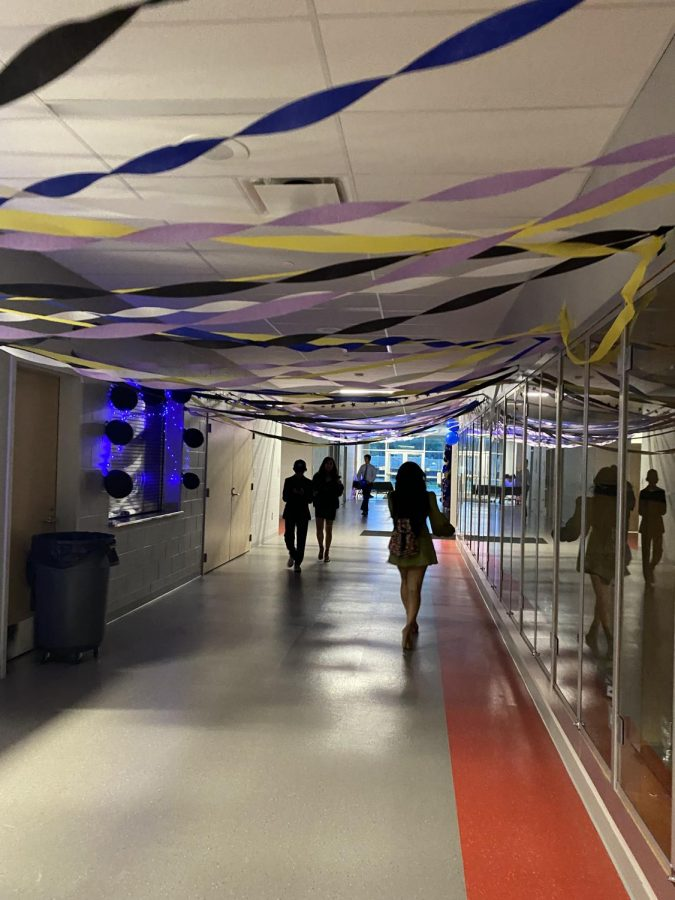 """The hallway is decorated in the """"Starry Night"""" theme to lead the way to the main gym."""