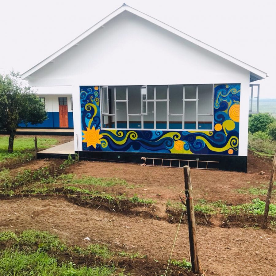 This is a picture of Mrs.Zustin's mural she painted in Africa.